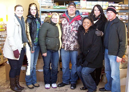 United Safety volunteers stocking all the food donations at the Holiday Train event in 2012